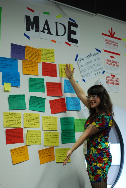 "Me standing in front of the MozFest ""To Make/Making/Made"" scrum board. Photo by Sammy James Dodds."